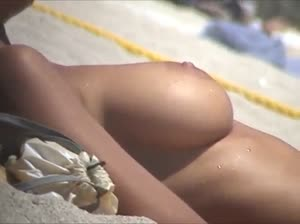 Super model Debora Bellow sunbathing topless